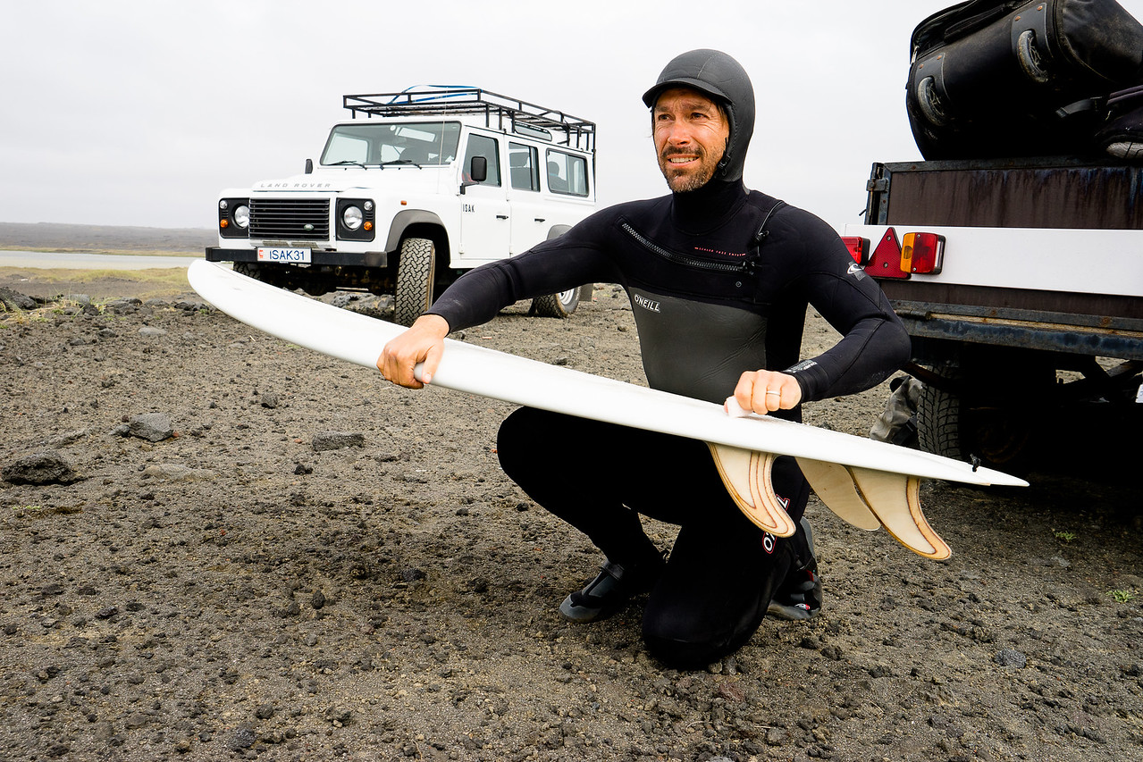 Jeremy Jones waxing up to surf in the south of Iceland