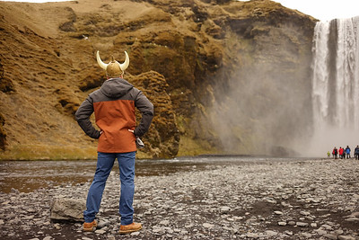 Posing at Skogarfoss with his horns. Tourist