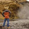 Posing at Skogarfoss with his horns. Tourist