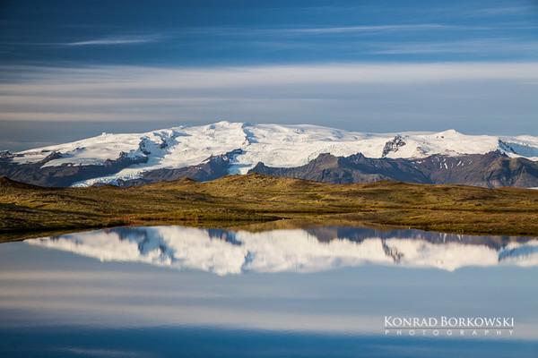 Vatnajokull reflection in a post glacial pond near Jokuraslon Lagoon.