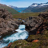 View of Seydisfjordur and waterfall in southeastern Iceland.