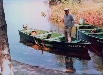 Mr. Ed Palmer in one of the classic wooden boats