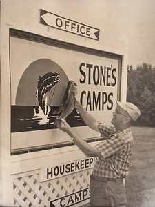 Mr. Minker's bass.  The day a camper caught a bass the same size as the Stone's Camps sign