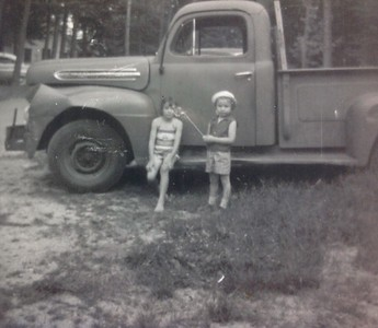 Charles Stone's classic Ford truck.  Jenny Stone on right (with hat), with friend, early 1960's