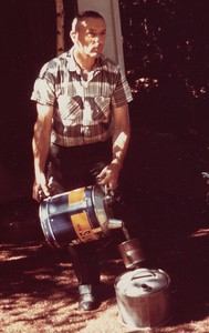 Charles Stone in an iconic shot, mixing gasoline in front of the storehouse