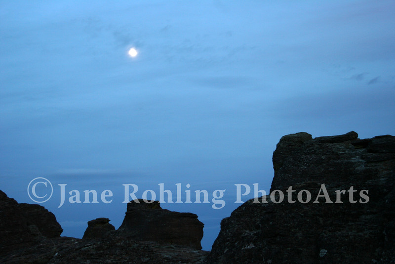 A full moon rising over silhouetted basalt hoodoos, Gooding City of Rocks north of Gooding, Idaho.