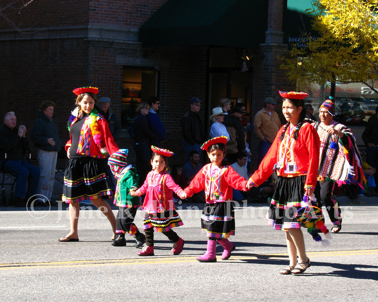 Peruvian women and children in colorful, traditional costumes, Trailing of the Sheep Festival parade, Ketchum, Idaho.