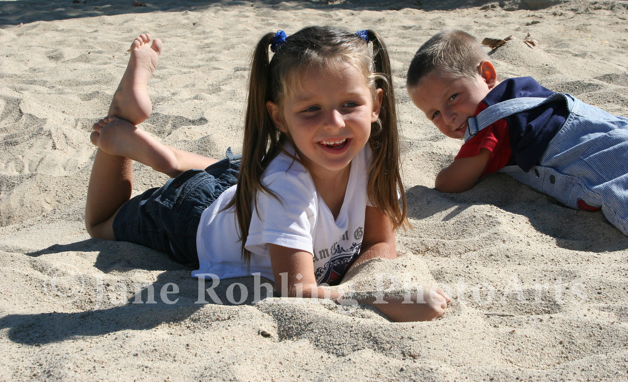 Sister and brother playing in the sand at Merrill Park in Eagle, Idaho.