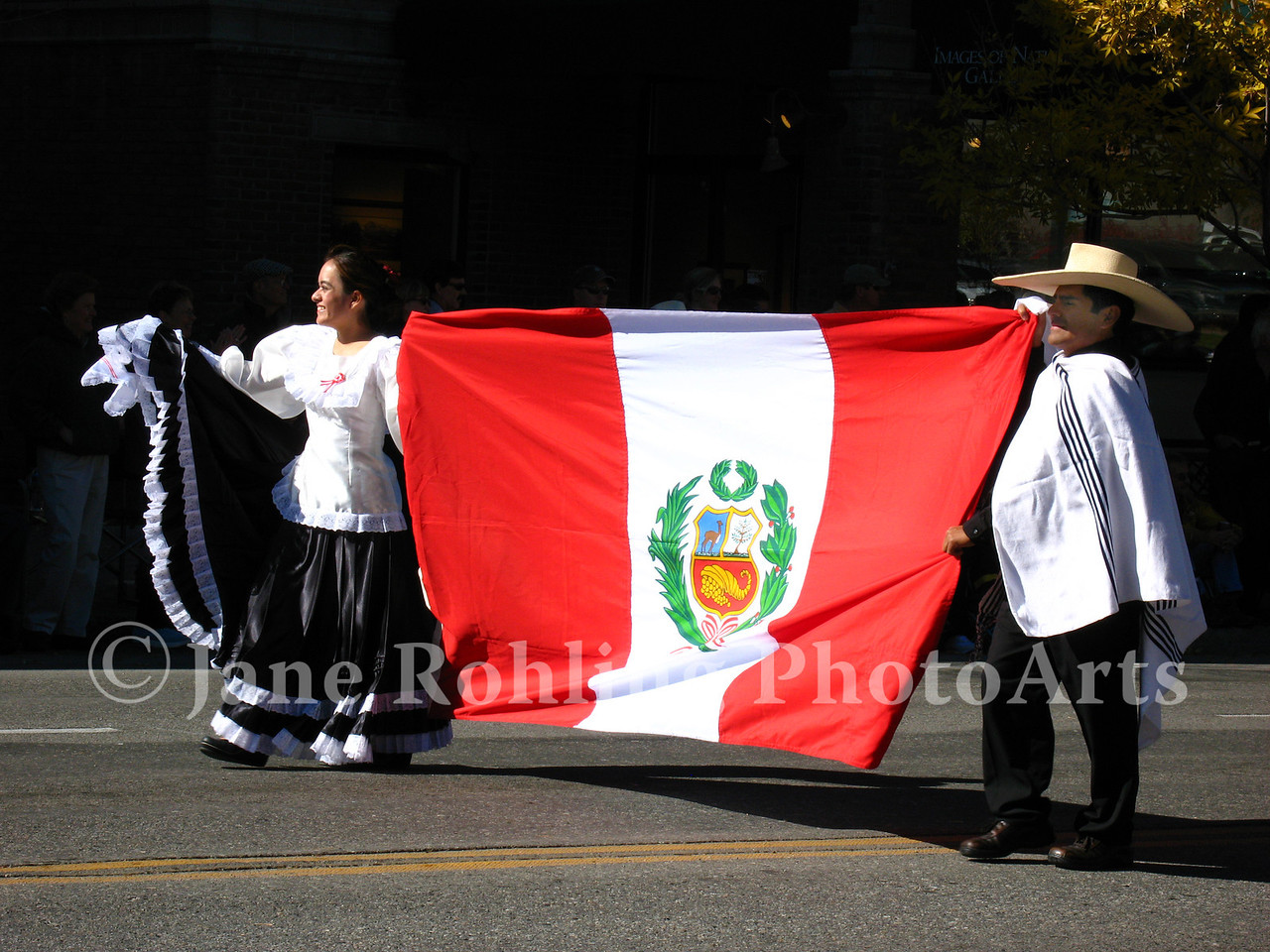 Peruvian immigrants carry the flag of their homeland in the Trailing of the Sheep Festival parade, Ketchum, Idaho.