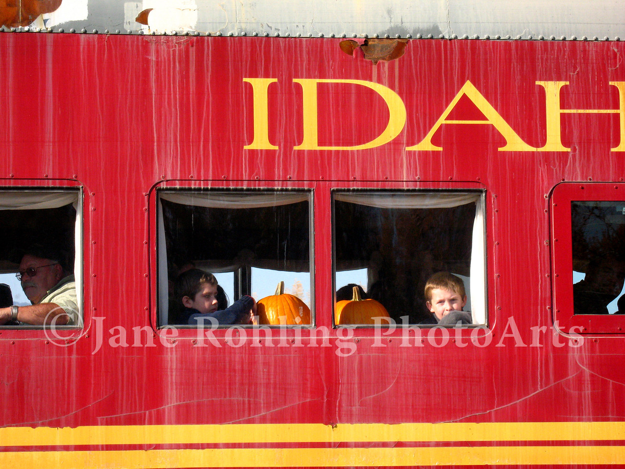 Happy kids return to Horseshoe Bend with their pumpkins on the Thunder Mountain Railroad, Idaho.