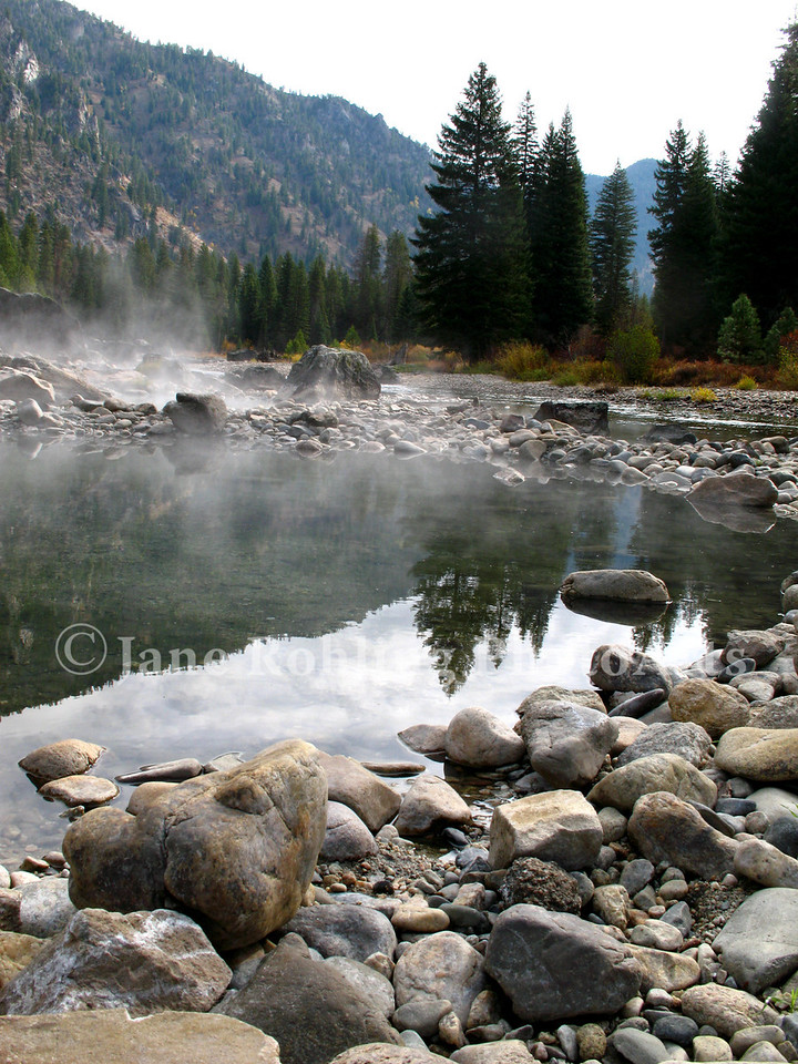 On a cool autumn morning, steam rises the hot springs on the South Fork of the Payette River near Grandjean, Idaho.