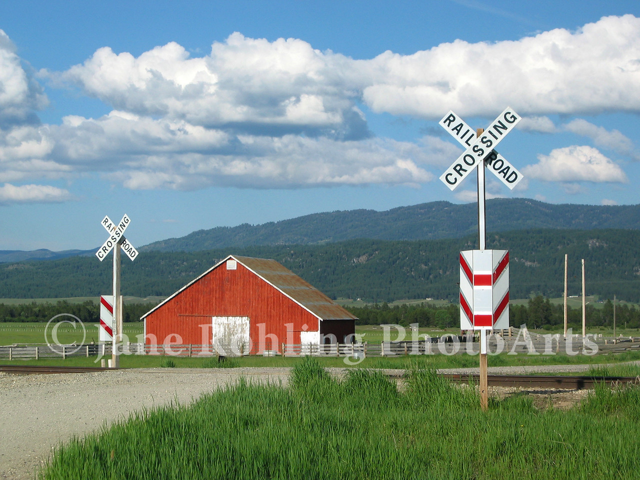 Red barn and rural railroad crossing near Cascade, Idaho.