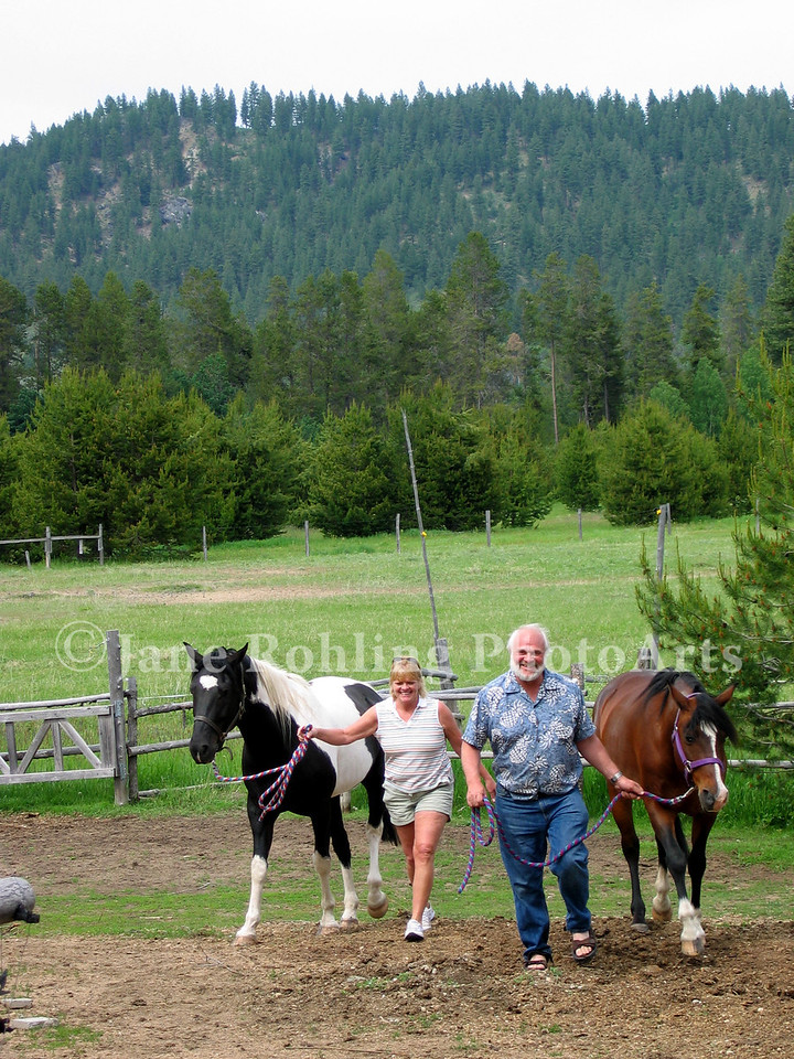 Couple with horses on ranch near Cascade, Idaho.