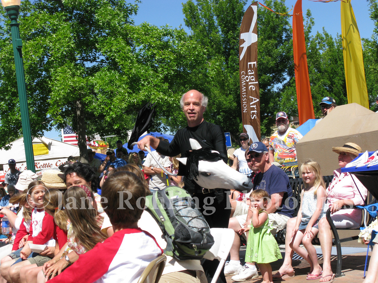 A performer entertains the crowd in Heritage Park in downtown Eagle, Idaho, during Eagle Fun Days.