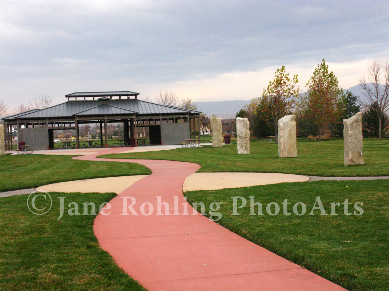 Stone pillars and a colorful walkway lead from the greenbelt on the Boise River to the picnic shelter in Merrill Park, Eagle, Idaho.
