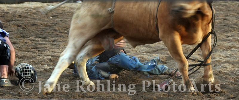 A bull rider takes a tumble in the Eagle Fun Days Rodeo, Eagle, Idaho