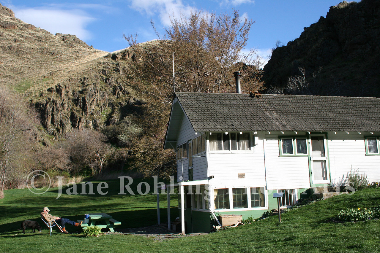 A US Forest Service volunteer takes a break at the Jordan House, historic Kirkwood Ranch, Hells Canyon National Recreation Area on the Snake River in Idaho.