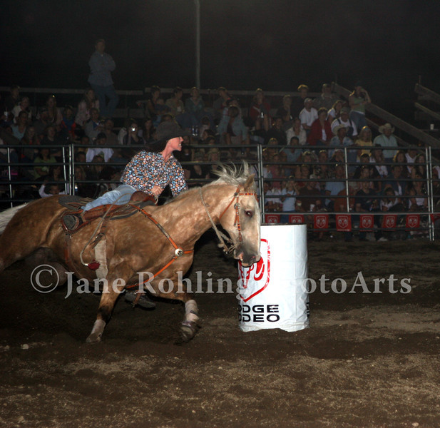 A barrel racer takes a tight turn in the Eagle Fun Days Rodeo, Eagle, Idaho