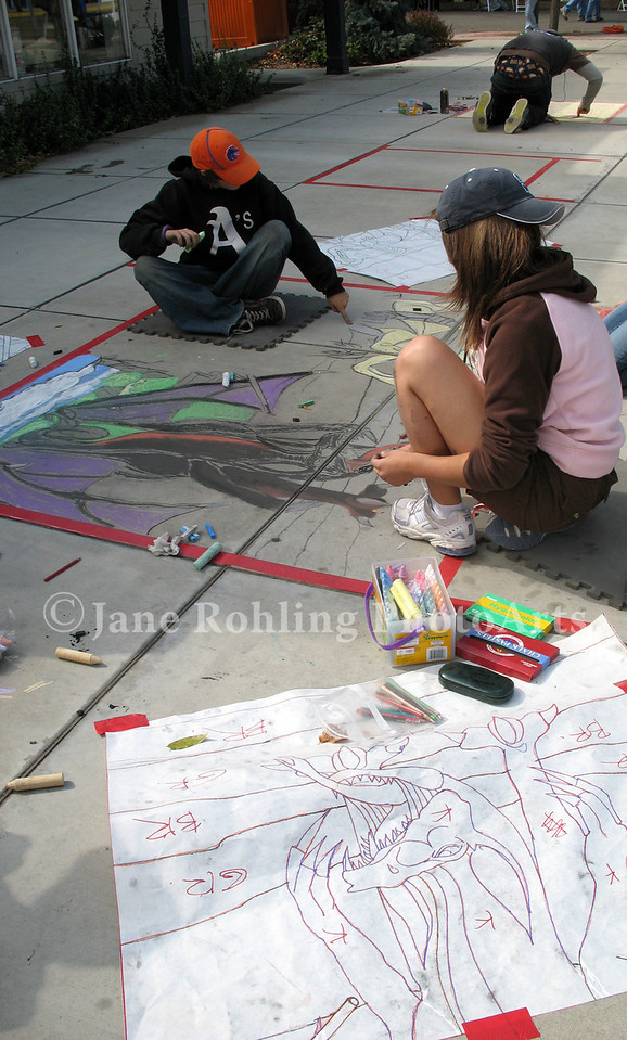 Arts West high school students decorate the sidewalks on State Street in Eagle, Idaho during the first Eagle Wine and Food Festival.