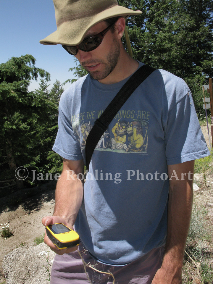 A man studies his GPS unit during a geocaching lesson at Bogus Basin Mountain Recreation Area near Boise, Idaho.