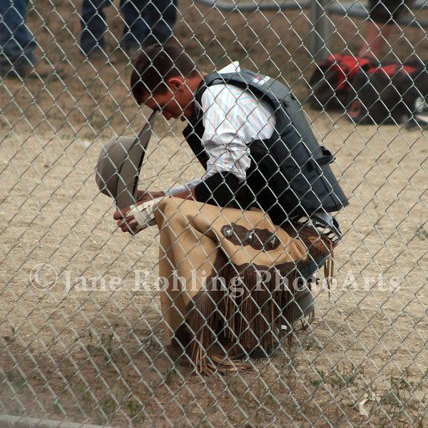 A cowboy prepares for his ride in the Eagle Fun Days Rodeo, Eagle, Idaho