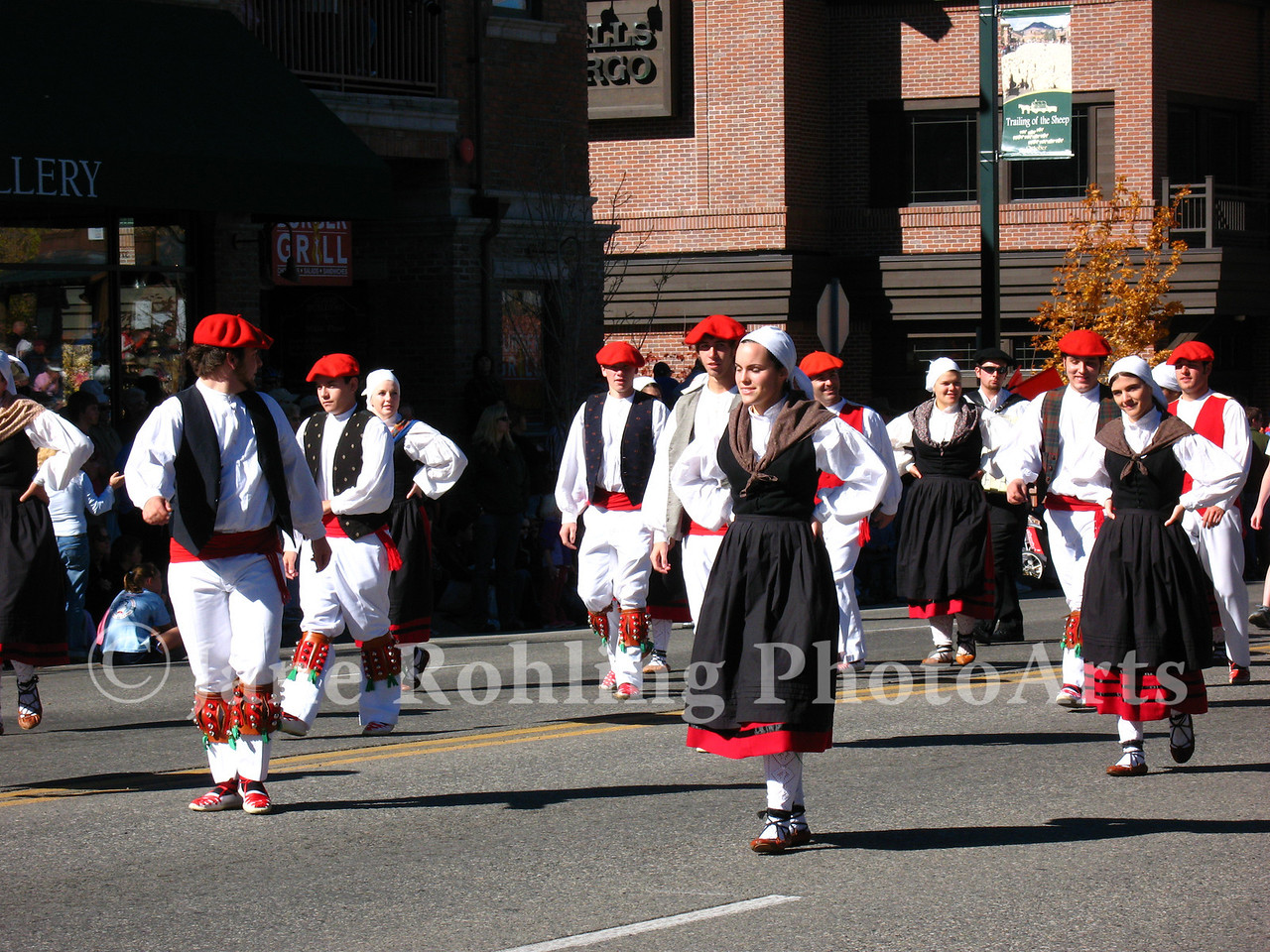 Basque dancers in colorful, traditional costumes in the Trailing of the Sheep Festival parade, Ketchum, Idaho.