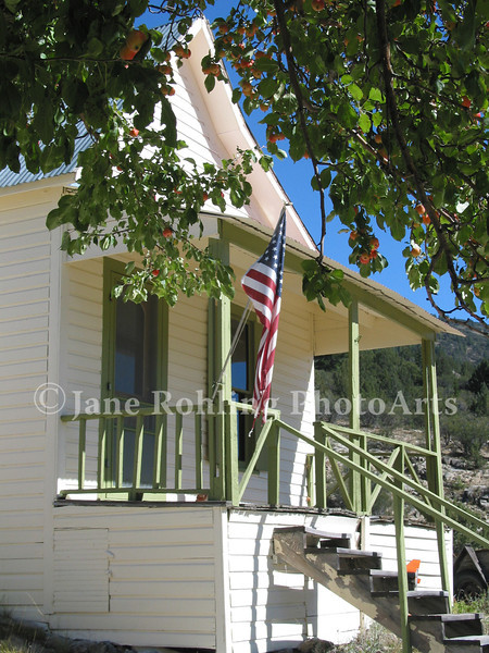American flag on the front porch of a home, Silver City, Idaho, Owyhee Mountains