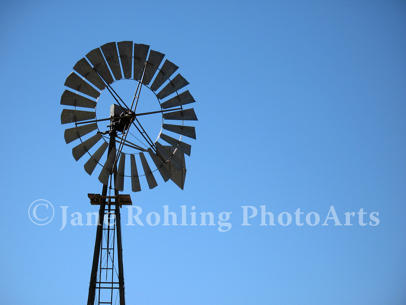 A windmill graces the blue sky in rural Idaho.