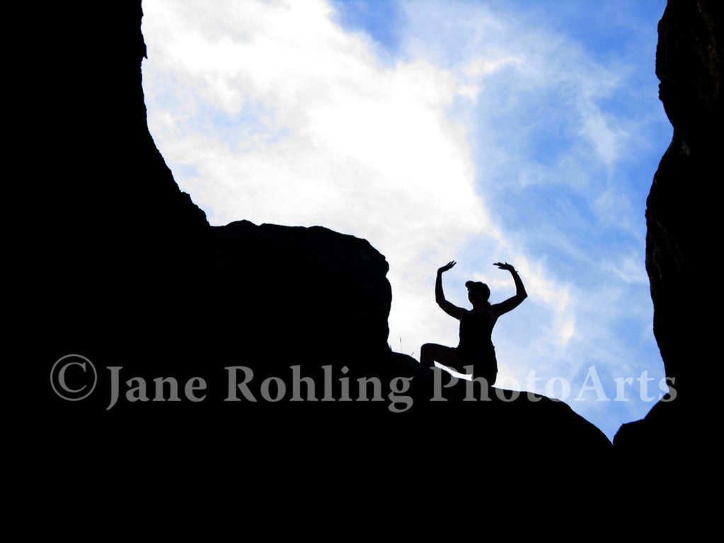 A jubilant hiker tops out, City of Rocks Natural Reserve near Almo, Idaho.