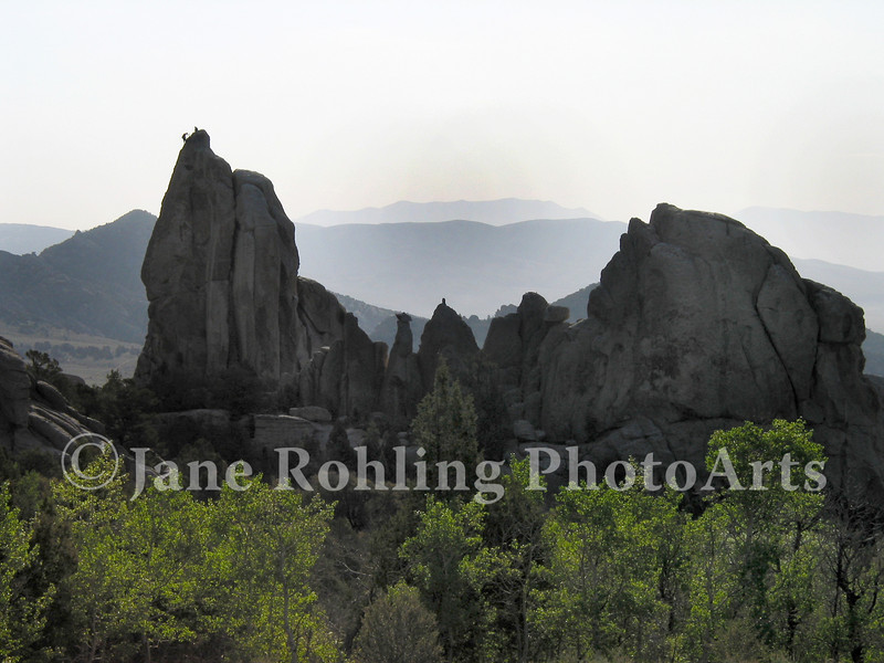 Rock climbers reach the top of a granite pillar  in the City of Rocks Natural Reserve near Almo, Idaho.