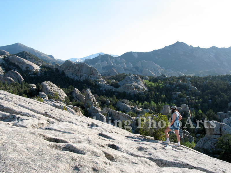 A hiker in the granite rocks of the City of Rocks Natural Reserve near Almo, Idaho.