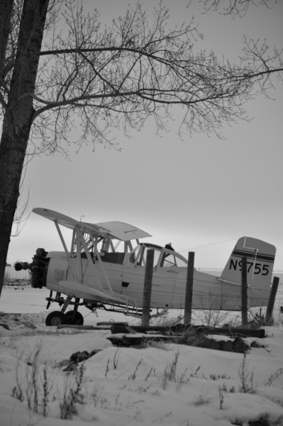 Yellow CropDuster plane.  rural Idaho. 2.09. converted BW