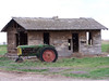 Abandoned Idaho homestead with tractor, color