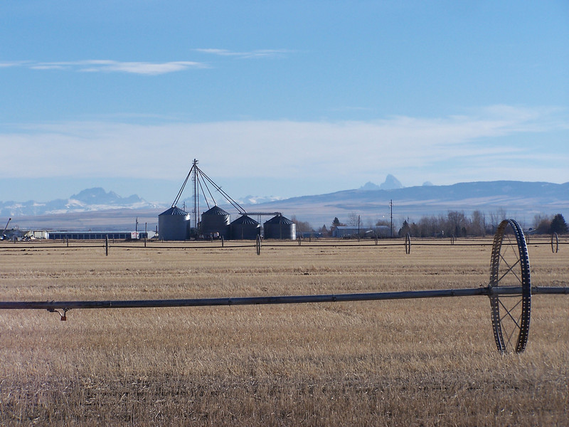 Irrigation system and Grain Bins with the Tetons in the background.  Rexburg, Idaho. 11.08