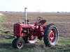 Farmall tractor in spring field, color