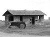 Abandoned Idaho homestead with tractor, black & white