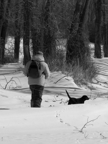 Boy and puppy along the river