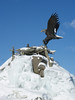 Eagle Bronze Sculpture, winter scene