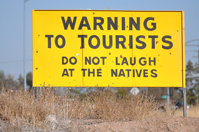 Warning to Tourist sign on Hwy 26 near Idaho Falls, ID. 11.09
