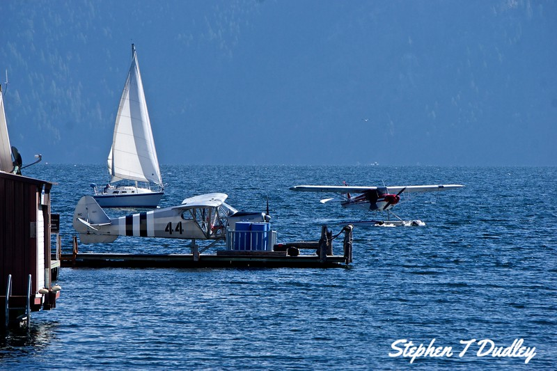 Seaplanes and sailboat in Bayview, Lake Pend Oreille
