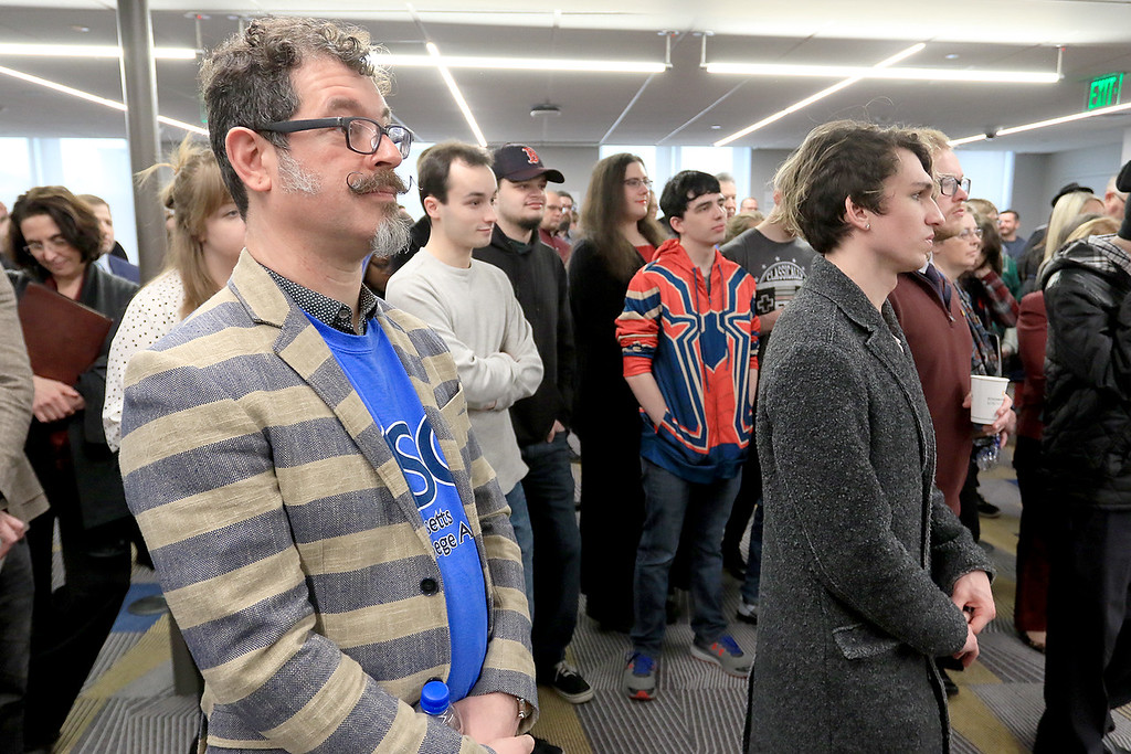 . Fitchburg States University\'s IdeaLab at the Theater Block on Main Street held it\'s ribbon cutting on Tuesday January 29, 2019. FSU\'s Professor of the Game Studio Capstone Course at the IdeaLab Jeff Warmouth, in stripped jacket, listens to the speakers during the event. SENTINEL & ENTERPRISE/JOHN LOVE