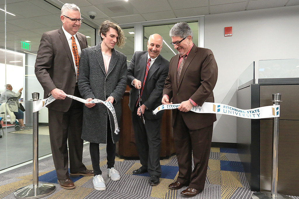 . Fitchburg States University IdeaLab at the Theater Block on Main Street held it\'s ribbon cutting on Tuesday January 29, 2019. Cutting the ribbon is, from left, Fitchburg\'s State Representative Stephan Hay, FSU senior Jules Stackhouse, FSU President Richard Lapidus and Fitchburg Mayor Stephen DiNatale. SENTINEL & ENTERPRISE/JOHN LOVE