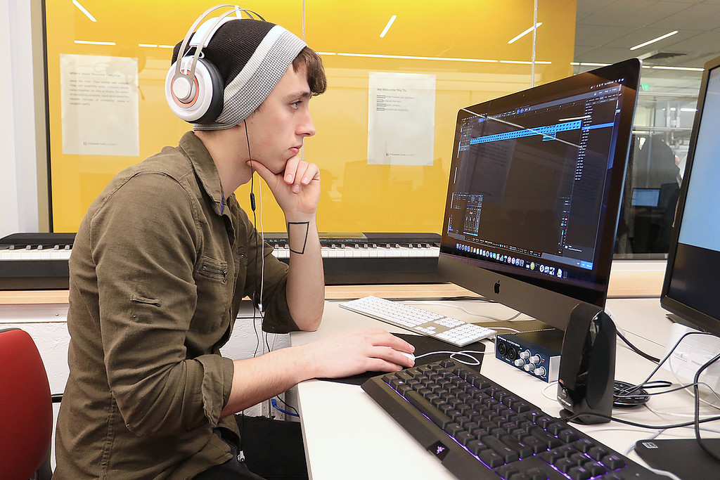 . Fitchburg States University IdeaLab at the Theater Block on Main Street held it\'s ribbon cutting on Tuesday January 29, 2019. Working on his music in the Game Studio Capstone Course at the IdeaLab after the ribbon cutting is FSU senior Joey Canney from Templeton. SENTINEL & ENTERPRISE/JOHN LOVE