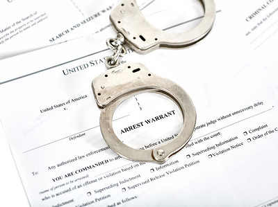 Arrest Warrant Court papers with Handcuffs