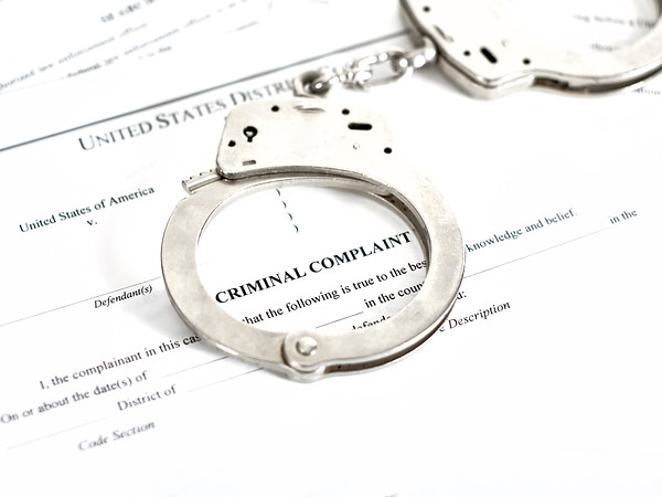 Criminal Complaint Court Papers with Handcuffs
