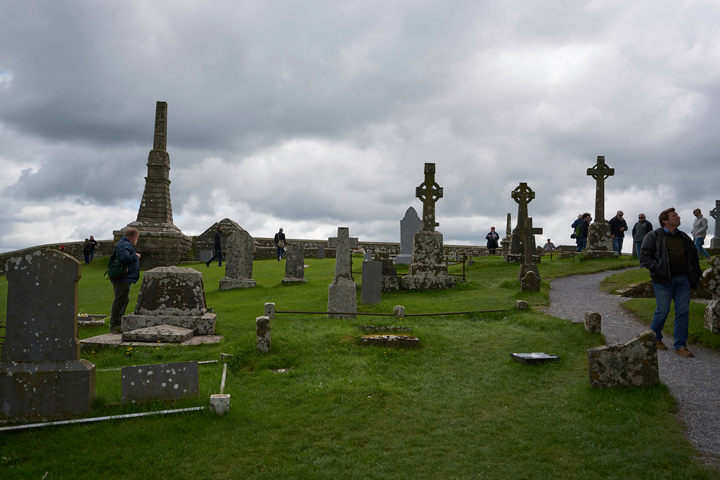 The grounds surrounding the buildings serve as an extensive graveyard, including a number of high crosses.