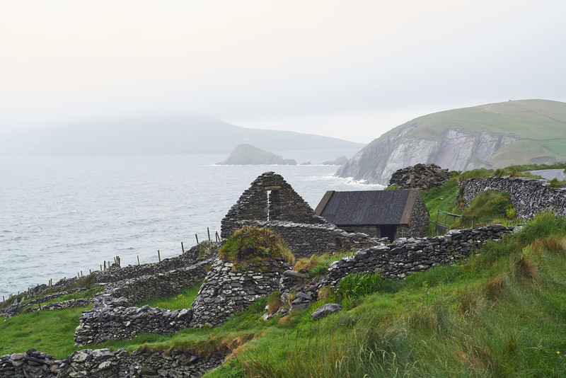 Note: the beehive hut on this farm adjacent to the ruin of a house or barn.<br /> <br /> In the background is Slea Head and across the Avonmore Sound, the Basket Islands.