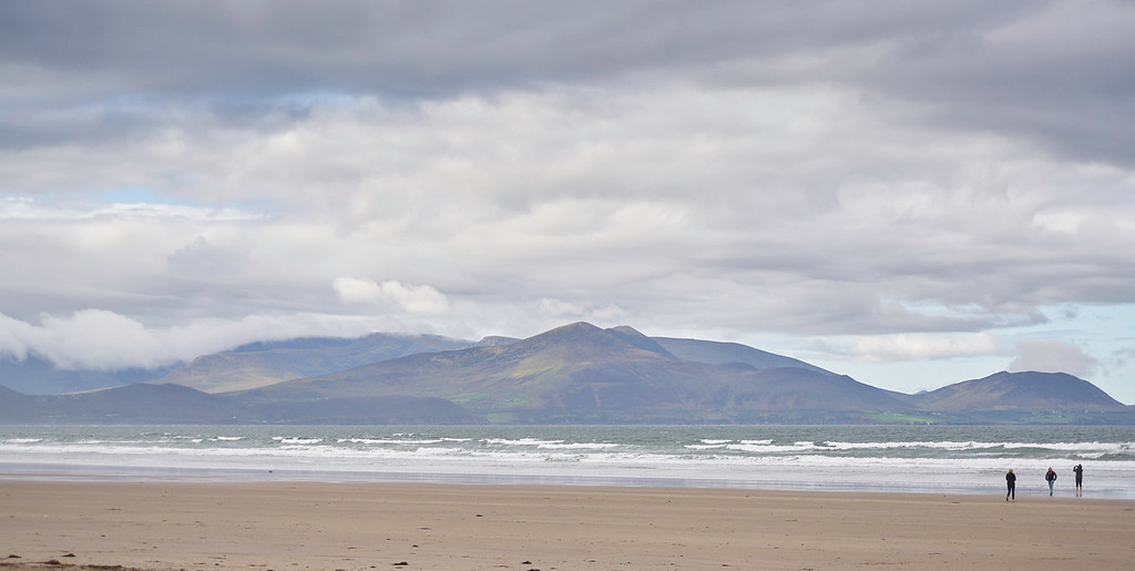 I loved the way the sun dappled through the passing clouds on hills of the Kerry Peninsula across Dingle Bay.  It made an amazing setting for a beautiful beach.<br /> <br /> Inch Beach<br /> Dingle Peninsula<br /> Ireland<br /> 2016