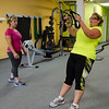 Yanina Fuasro, of Ignite Fitness Performance, looks on while Bobby Jo Cartee works out at the gym, which recently moved to Lunenburg. SENTINEL & ENTERPRISE / Ashley Green
