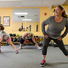 Kelly, 9, Jackie, 13, and Katie Hayden work out at Ignite Fitness Performance, which recently moved to Lunenburg. SENTINEL & ENTERPRISE / Ashley Green